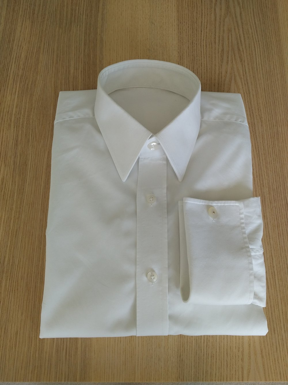 Shirts and Blouses  -  Our shirts and blouse goes along with the modern time we live in.This is why we offer both Bespoke Made To Measure and Bespoke Hand Stitched shirts and blouses.All our shirts and blouses will be designed from scratch starting from a blank piece of paper were we will draw your pattern using our in house roules.Bespoke Made To Measure shirts and blouses will be finished by our tailors in line with modern machine tecnique.Bespoke Hand Stitched shirts and blouse will have included in the process the baste fitting, allowing us to have the best unique pattern for you!Bespoke Hand Stitched products will have