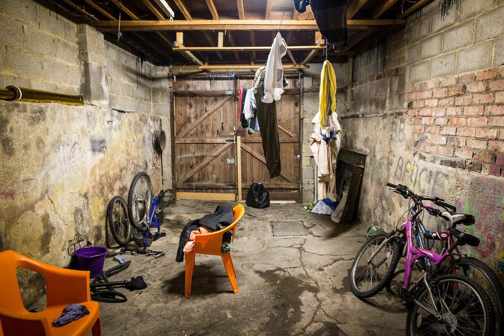 The garage at a refugee's council flat in Harrogate, where he and his housemates dry their washing and maintain their bikes  Photograph: Charlotte Maxwell for Point.51