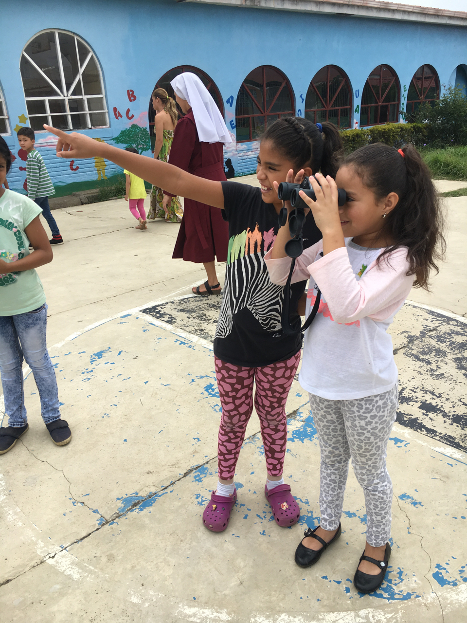 Teaching girls how to bird at an orphanage
