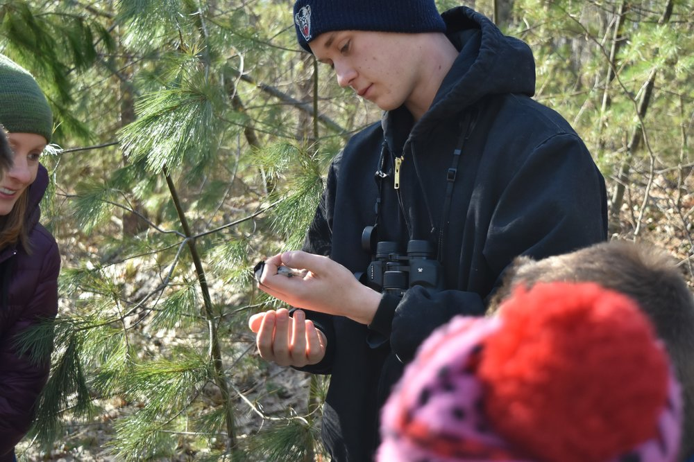 Josh holding one of the banded Chickadees