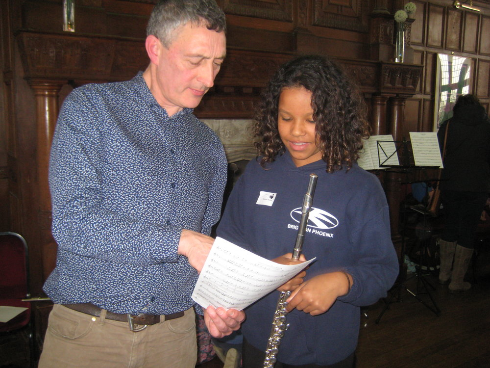 That's Mike Mower talking to one of our young flute players at an event