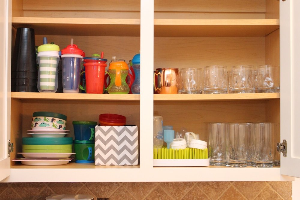 Kitchen kids and cups cupboard.jpg