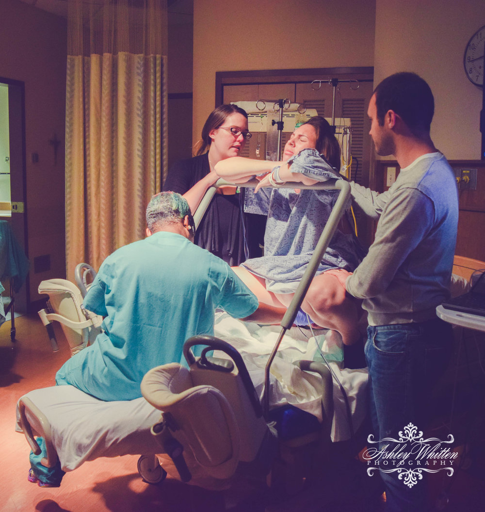One of our birth doulas, Heather Bruhn, working with a client, partner, and doctor during labor. It takes a team!