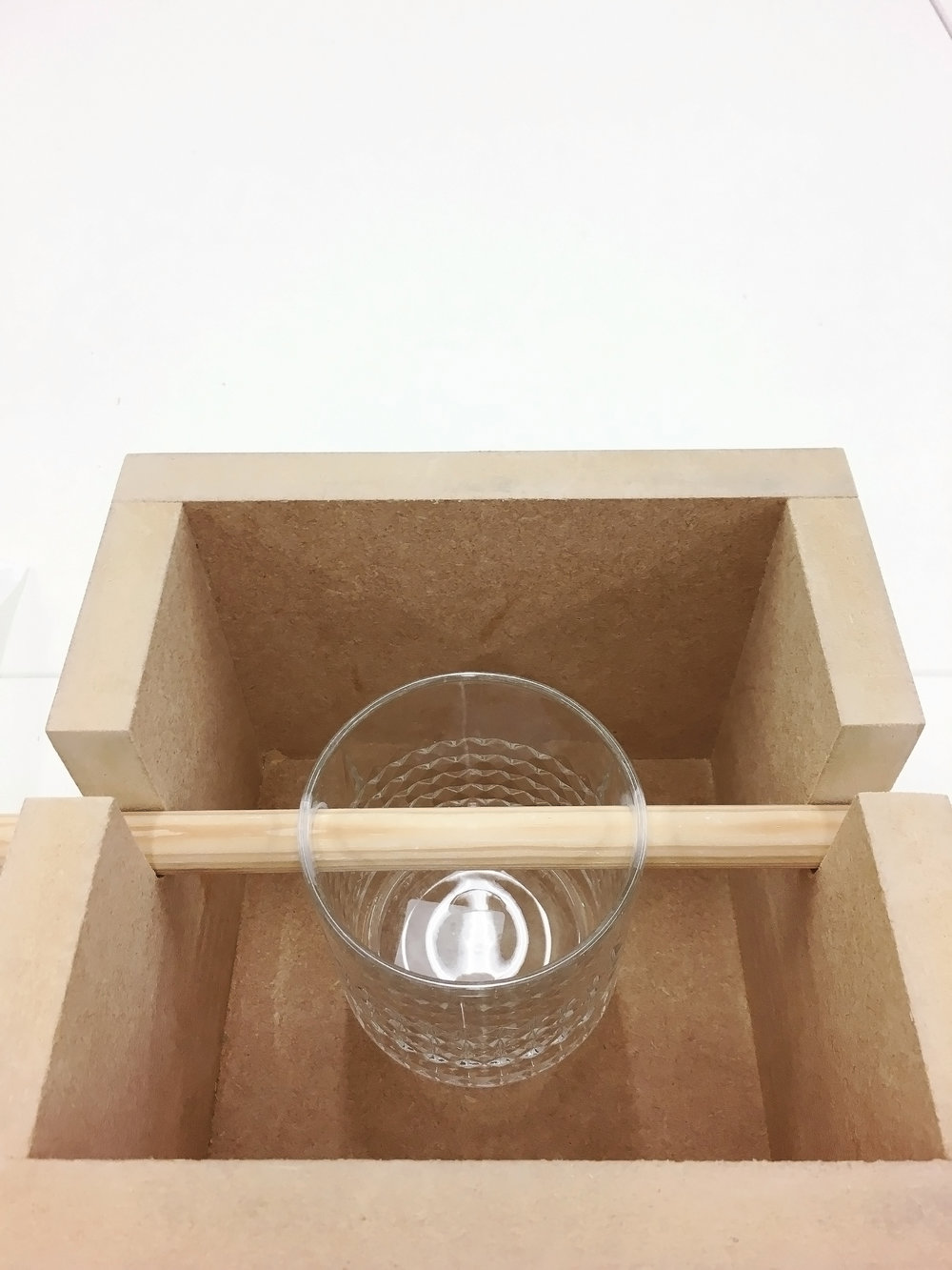 The new Quaich system is based on mutual body interaction between the two participants. They stand face to face, one holds the wooden bar, the other holds the bottom of the glass slowly tilting it to aid the partner to drink. This quaich embodies understanding, trust, induction and care which can be felt during its use.