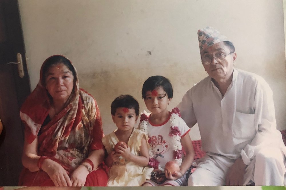 Niyati (second from the right), her younger sister, and her parents on her younger sister's first birthday.