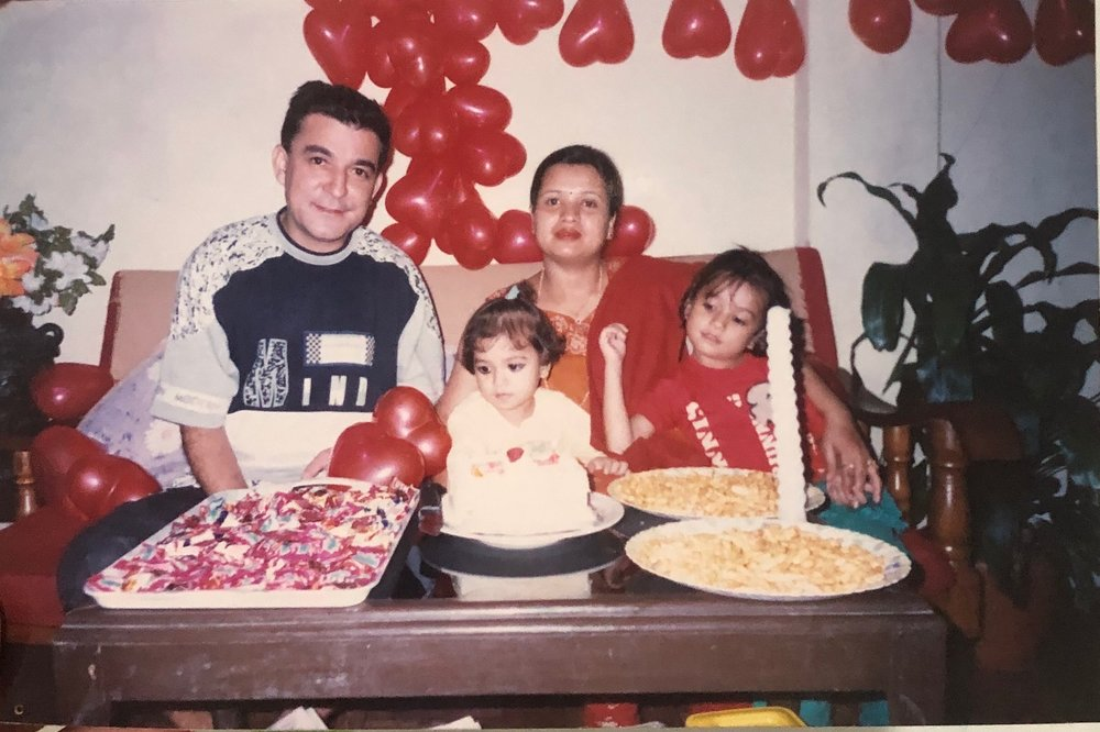Niyati, her younger sister, and her grandparents on the day before her family emigrated to the United States.