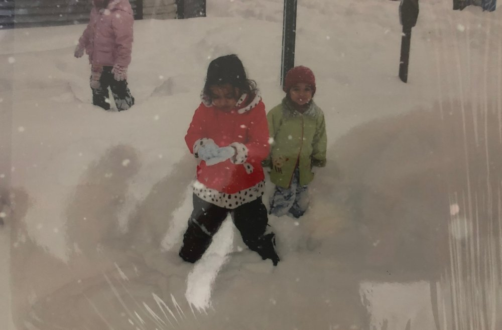 Niyati and her younger sister experiencing their first snow in New York.