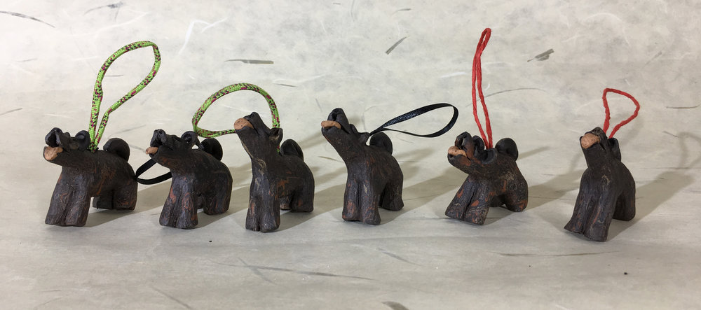 three pairs of ceramic dog wind-weights