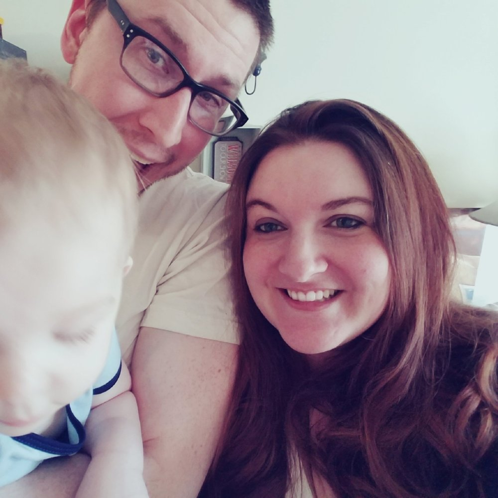 Me, with the legal department, and our adorable blur of a son, in our mid-western home.