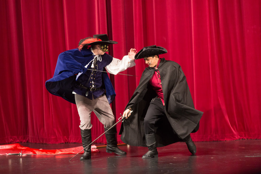 Sidenote:  While you can easily do the Three Musketeers with wooden swords if you have the resources to get metal stage combat swords, do. There is nothing quite like the sound of a real metal sword fight to bring home the swashbuckling flavor.