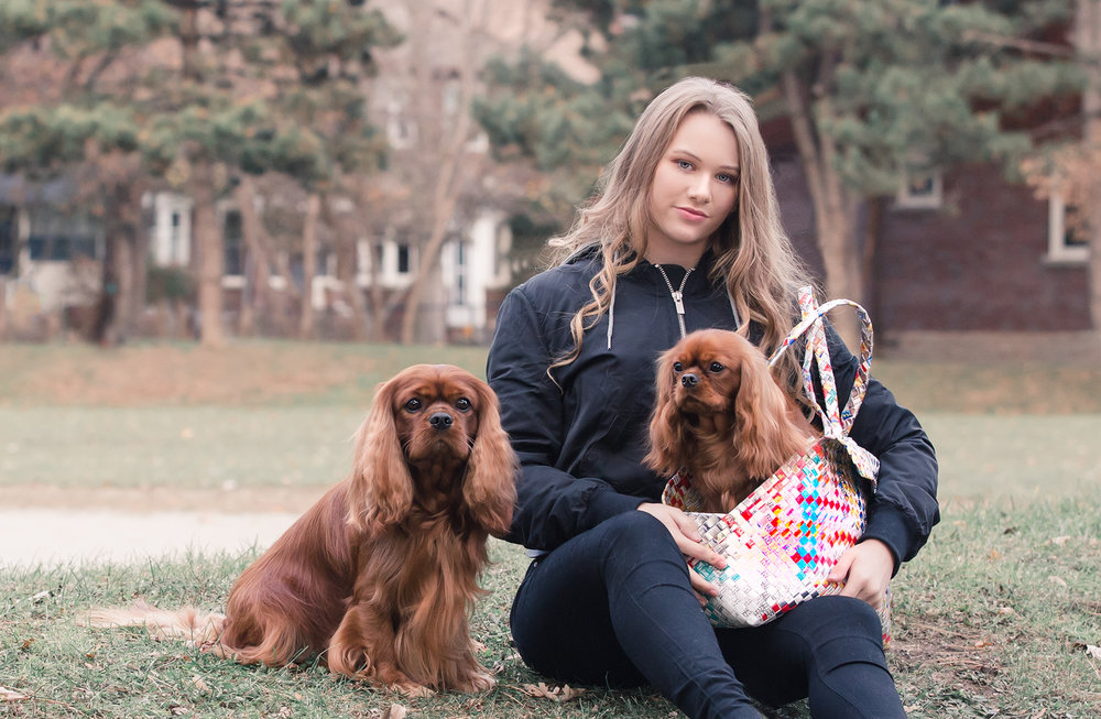 Girl with 2 dogs at a Toronto dog park