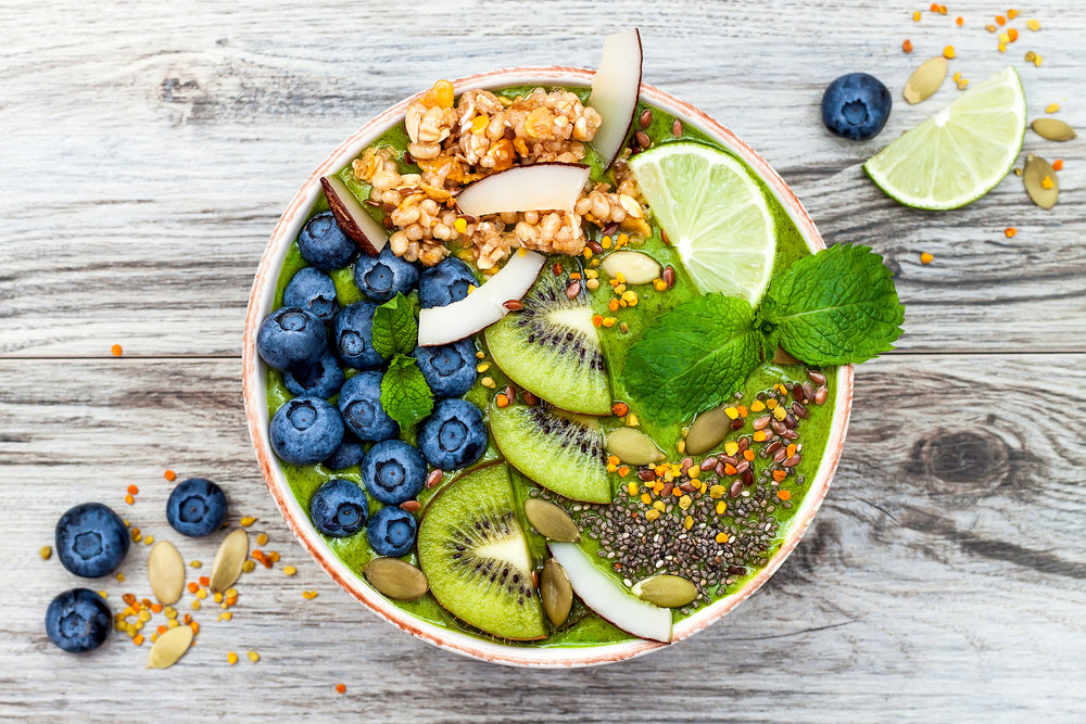 matcha-green-tea-breakfast-superfoods-smoothies-bowl-topped-with-chia-flax-and-pumpkin-seeds-bee-pollen-granola-coconut-flakes-78204532.jpg