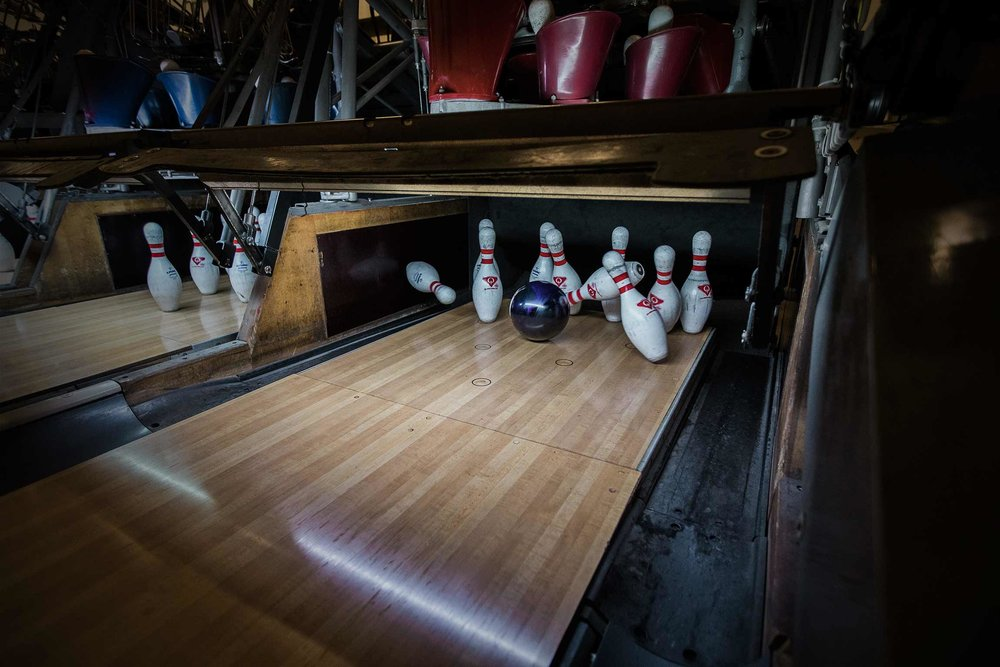Bowling pins being knocked down in a strike