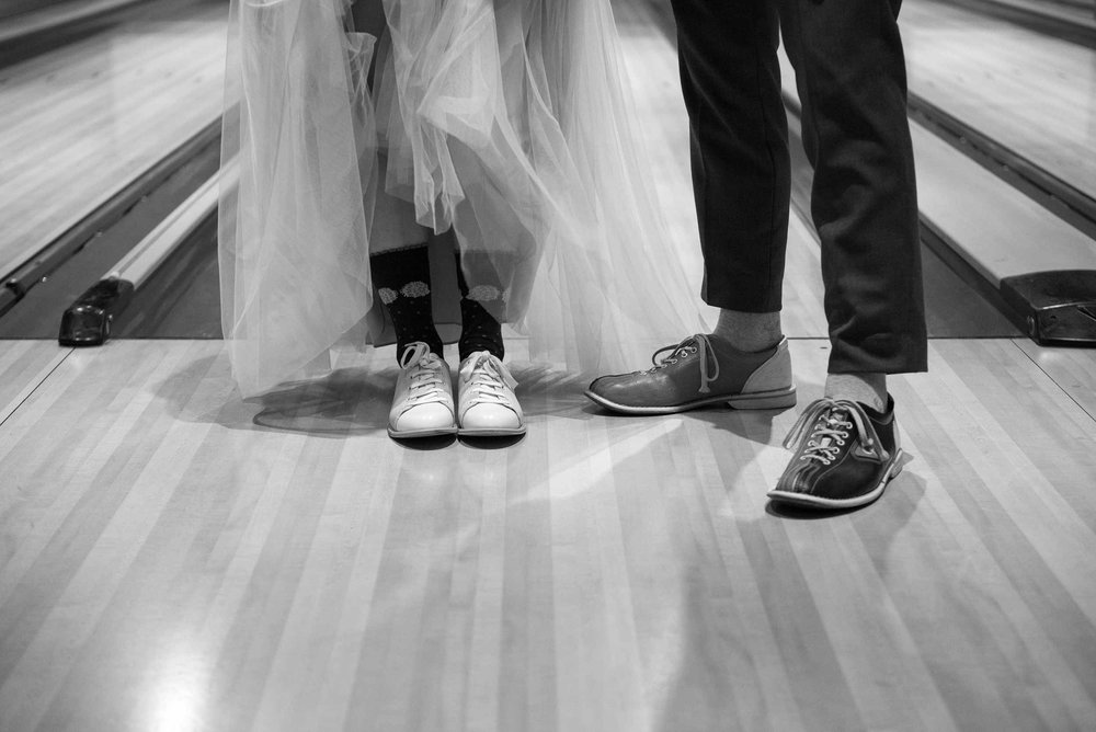 Bowling shoes on bride and groom