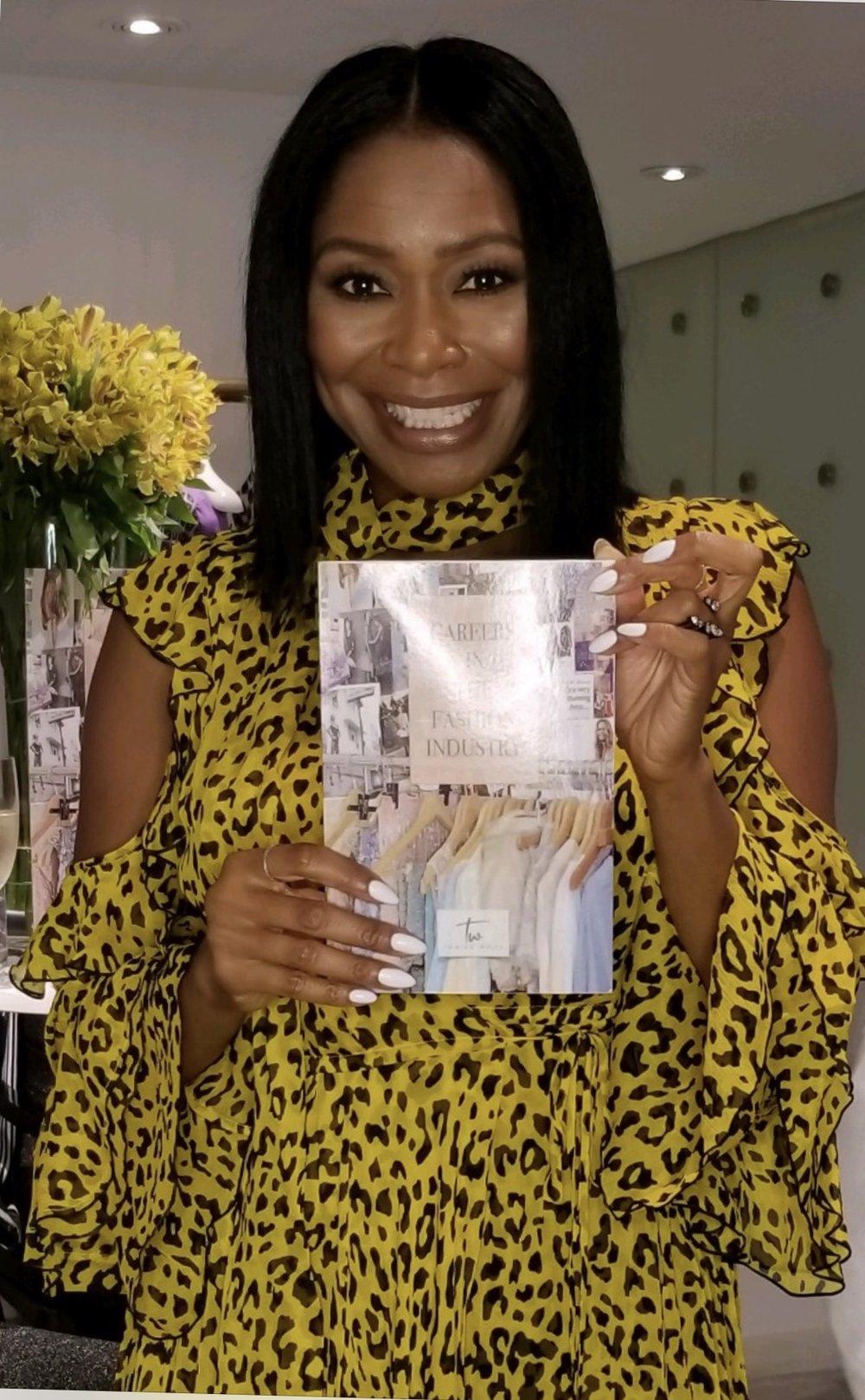 Tamiko at DVF holding book.jpg