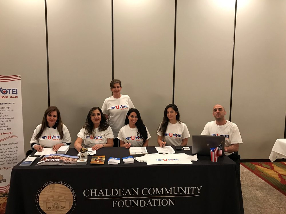 Bahri and her team prepare to register Chaldean voters at a community event.