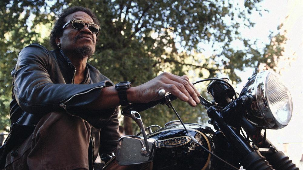 Artist-on-motorcycle.jpg