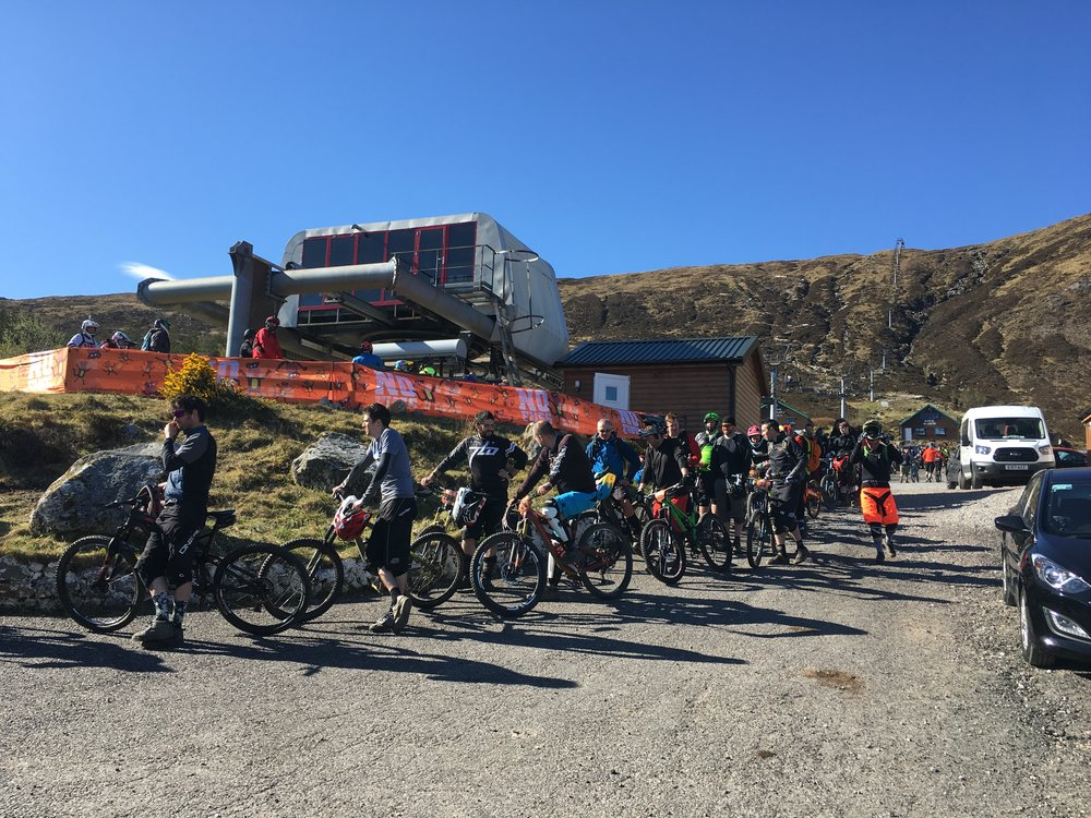Riders eager to get up the lift for stage 1, chilling and chatting in the sun