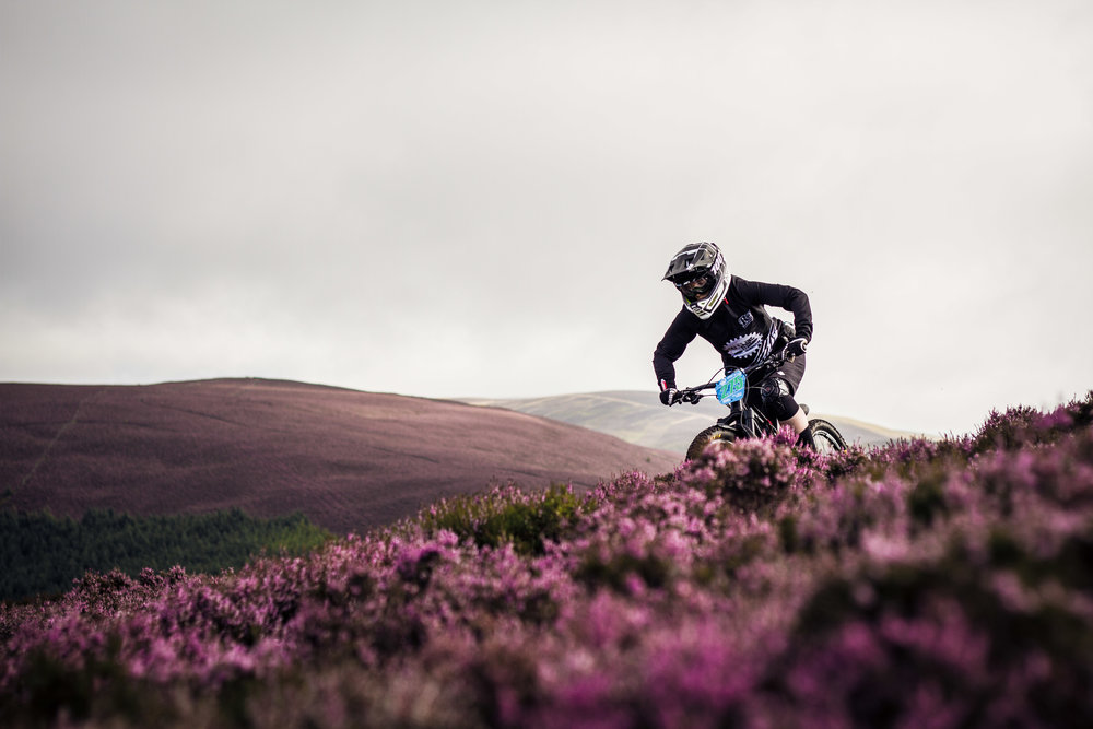 Dropping through the heather into stage 1          Pic by Finlay Anderson