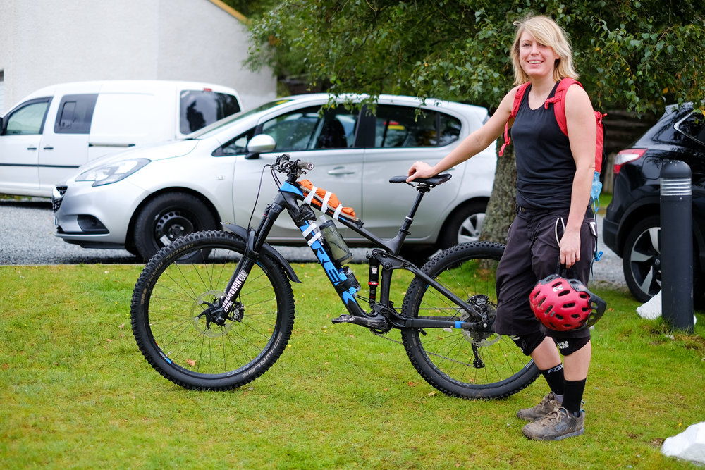 Ellie proving that you need neither a big bag or fancy bike packing gear to carry your stuff!