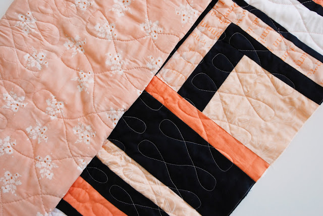 loop-de-loop quilting on peach and navy modern improv quilt