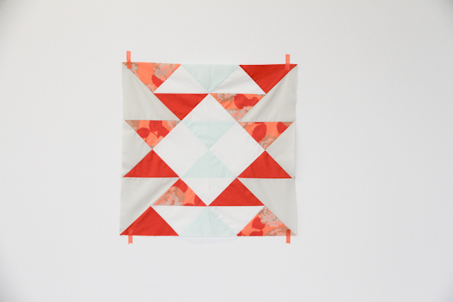 modern mint and coral aztec quilt top taped to wall | by Lovely and Enough