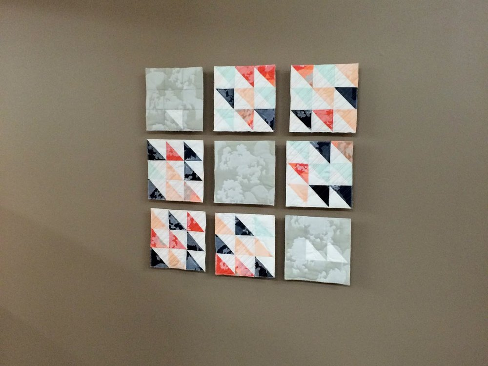 Remnants of Summer printed modern wall quilt living in its Wheaton College home | by Lovely and Enough
