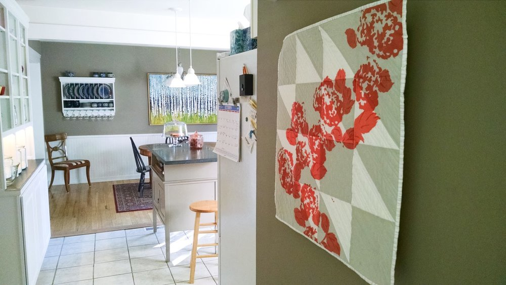 New Growth coral modern printed wall quilt living in its Ann Arbor home | by Lovely and Enough