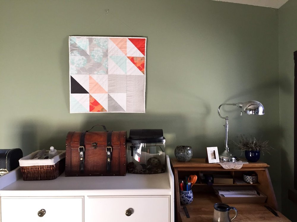 Fresh Starts mint and coral modern wall quilt living in its Wheaton home | by Lovely and Enough