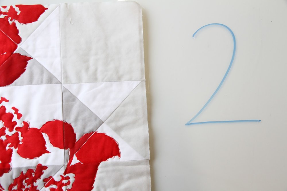 hand-printed modern quilt in red on low volume Ohio Star | by Lovely and Enough