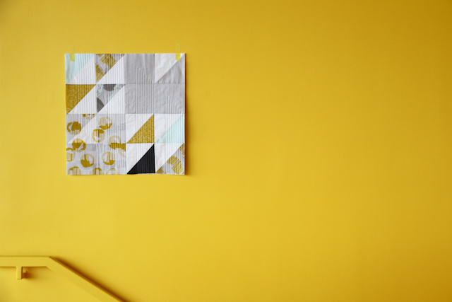 printed and quilted wall quilt with screen printing on yellow wall