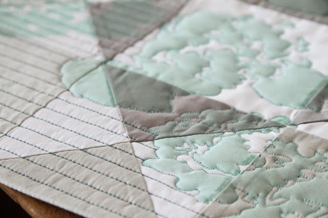 modern mint printed quilt with free motion and straight line quilting: crisp, subtle, and gorgeous | by Lovely and Enough