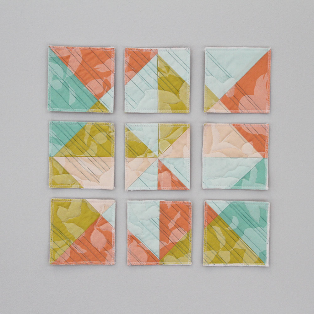 printed and deconstructed modern wall quilt in fresh spring colors