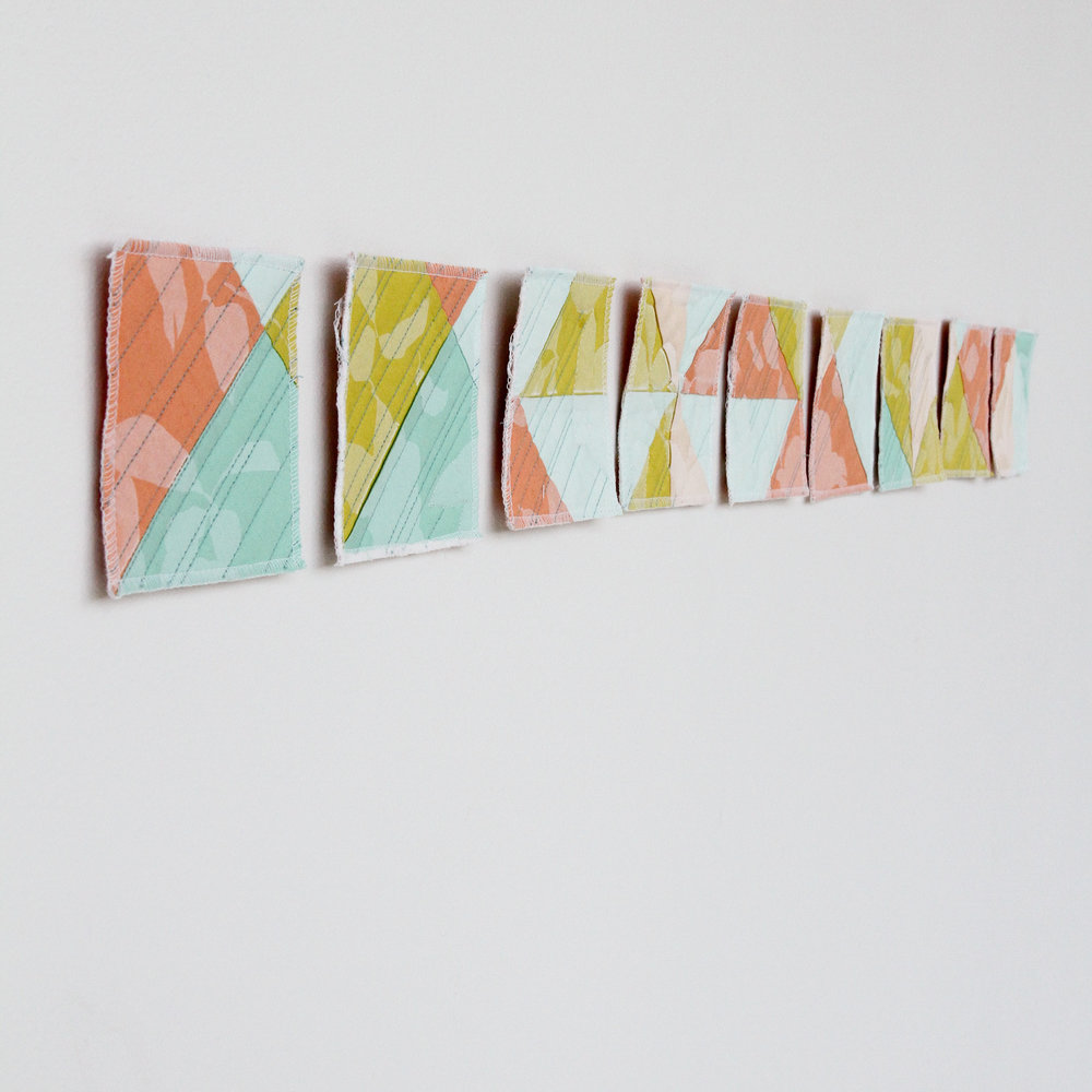 printed and deconstructed modern wall quilt rearranged from grid to line