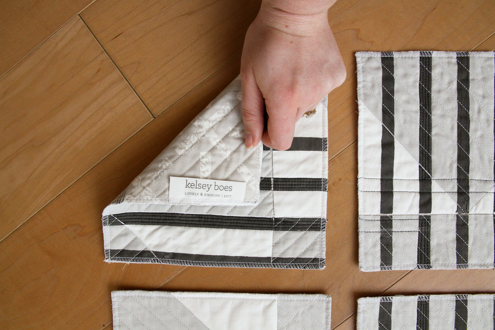 deconstructed and printed black and white modern quilt with DIY professional label