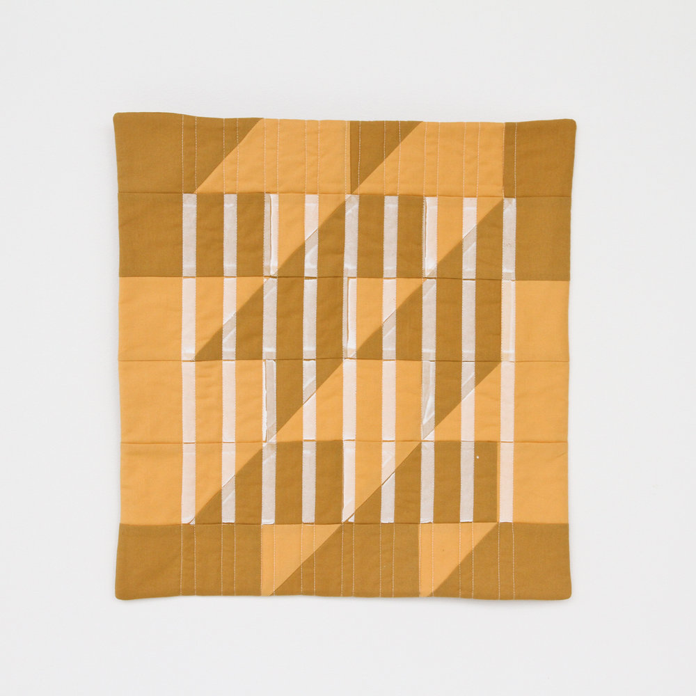 mustard modern quilt overprinted with minimal white stripes || designed, pieced, printed, and quilted by Kelsey Williams of Lovely and Enough
