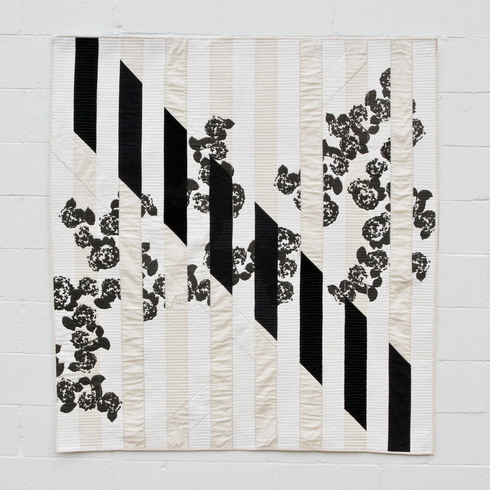 modern black and white quilt screen printed with hydrangea blooms | by Kelsey Williams of Lovely and Enough