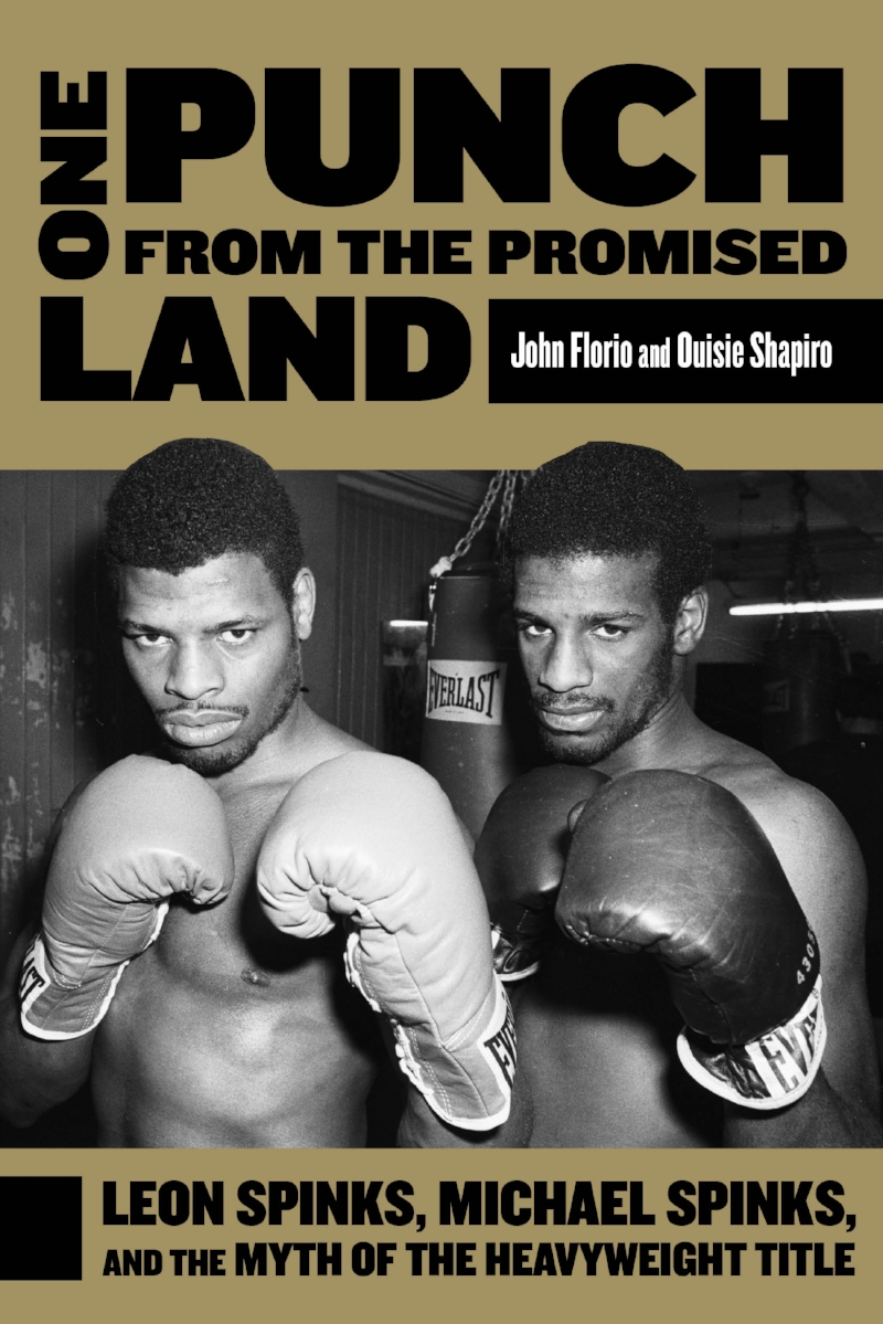 "One Punch from the Promised Land (Florio-Shapiro)    Former heavyweight champions Leon and Michael Spinks battle their way out of the housing projects. Does America want them to make it?   ""Just as much about America's racial and socioeconomic situation as it is an exploration of the dynamics of family and the history of the sweet science."" – Publishers Weekly    ""An excellent read."" – Booklist"