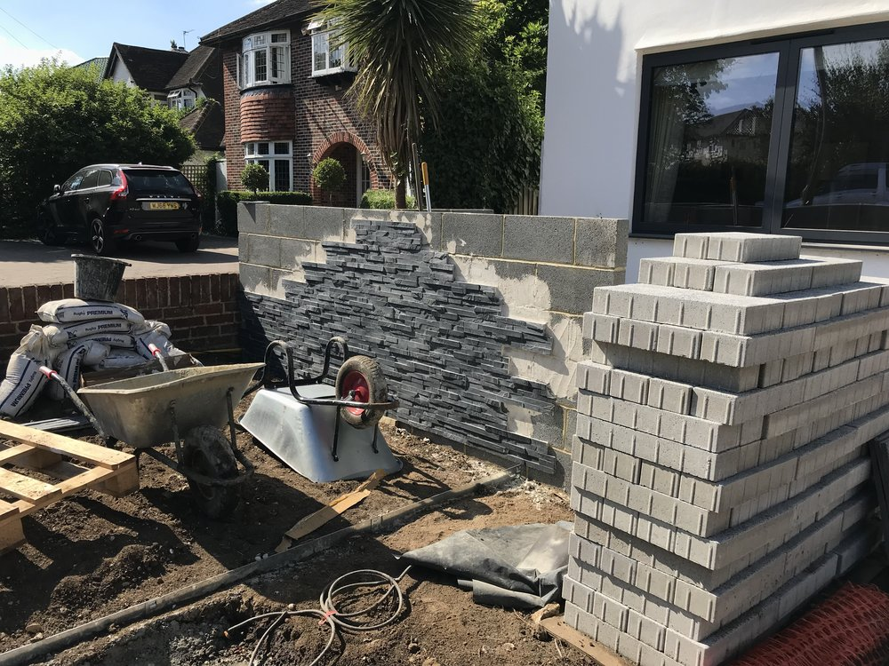 Slate wall to bin store under construction.