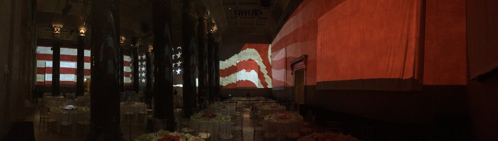 Panoramic view of the space.  Obstructed sightlines added a challenge to telling a dialogue-free narrative. The far wall had the major narrative, and the two side running walls had supporting animation to completely immerse the viewer.