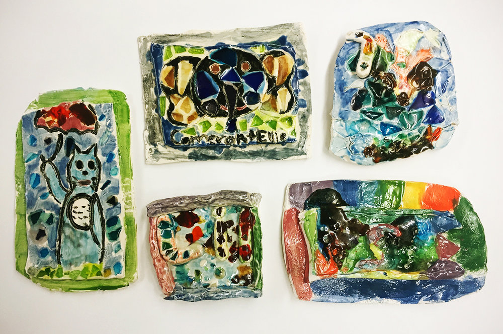 Ceramic tiles with melted glass