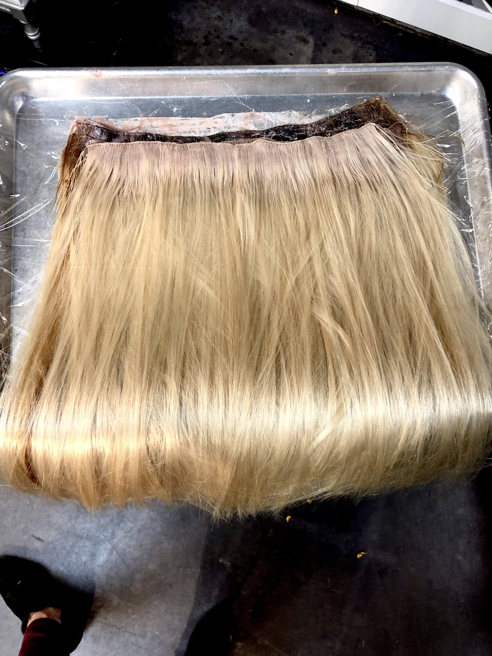 "Adding just a bit of a shadow on the ""root"". Having deeper color at the scalp mimics what your hair would naturally do and adds even more disguise to your hair extensions."