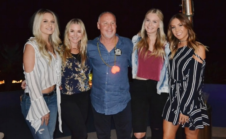 PS. CAN WE TALK ABOUT HOW CUTE DAD IS WITH HIS GIRLS!? THE PIN ON HIS SHIRT READS: 'I AIN'T DEAD YET MOTHER FUCKERS' CHEERS TO 60, DADDIO.