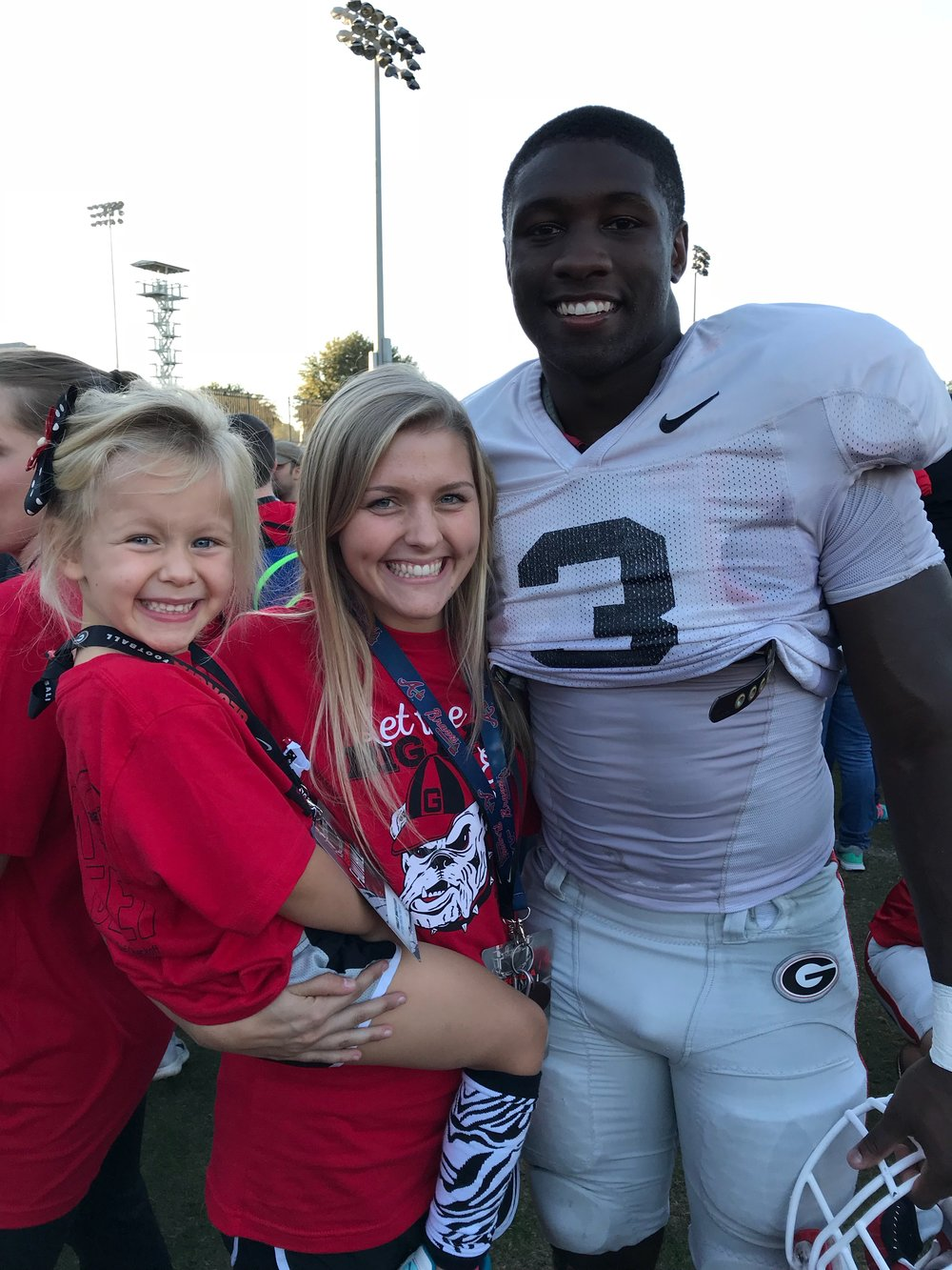 My little 5 year old Finley, Nicole Andrews & UGA's Roquan Smith