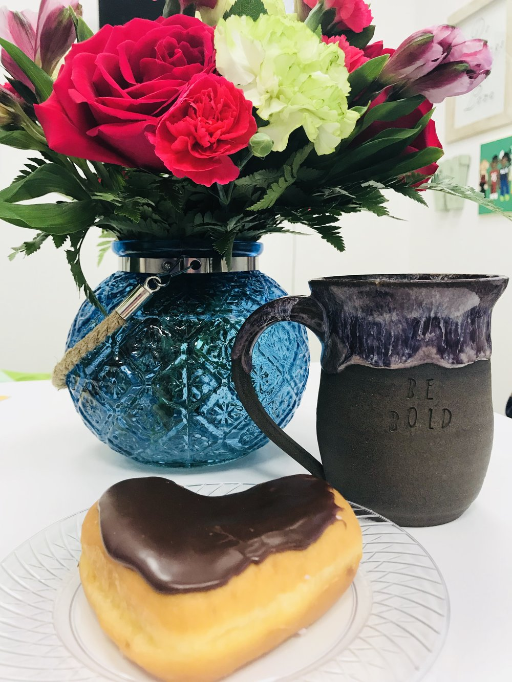 My current desk situation— fav donut (so many carbs around here), coffee and flowers from a sweet friend.