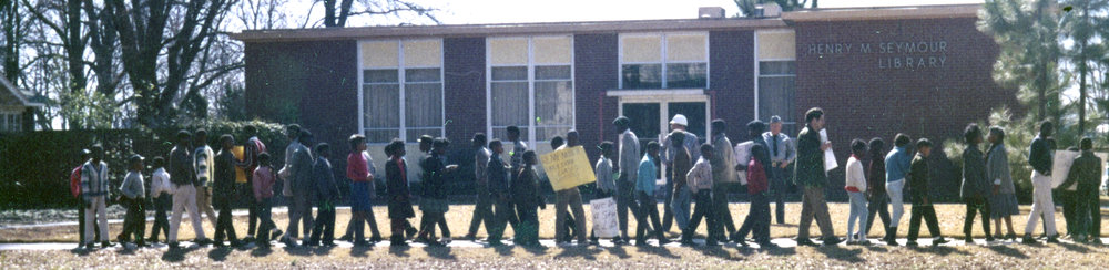 Indianola youth march for the right to use the Henry M. Seymour Library in 1964