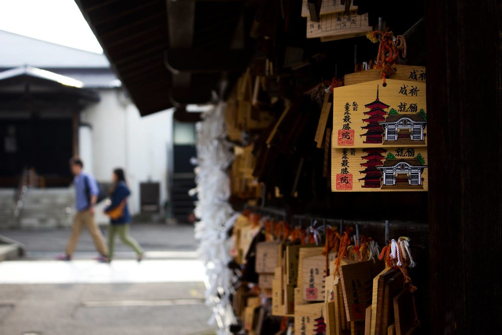 Fortunes at Japanese temples and shrines are not always perfect. If one doesn't agree with their fortune, they can leave it behind to change the course of fate. Photo by Brett Luft
