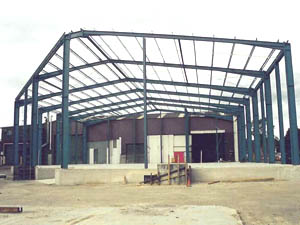 Structural steel including particularly portal frames, piers to footings and concrete floor slab.