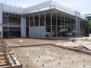 Steel reinforcement to concrete paving, structural steel frame and to precast wall panels.