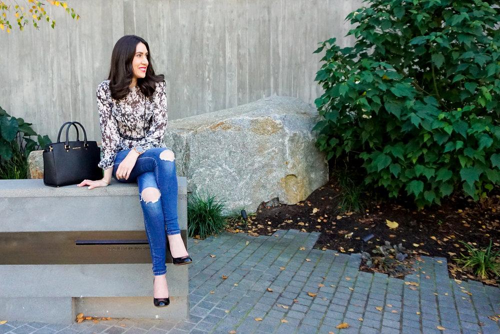 Lisa wears:  Chalk Floral Silk Blouse by David Lawrence , Jeans by Zara.